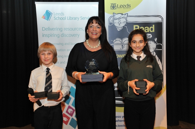 Kim Slater holding her Award for 'Smart,'  presented to her by Leeds young people
