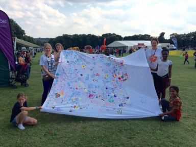 A special canvas filled with messages from hundreds of children at Breeze for Lebanon