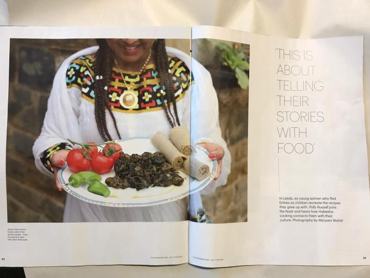 Illustrates the blog - young Eritrean woman holding a plate of food